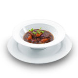 Hot delicious beef cooked in a red wine sauce. Stock Images