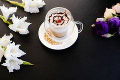 Hot delicious cappuccino coffee dark background stock photo
