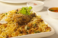 Hot delicious chicken biryani. Hot delicious chicken biryani is a made up of chicken, rice and spices cooked together Royalty Free Stock Image