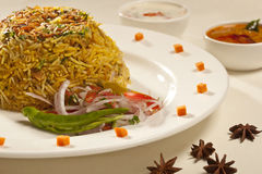 Hot delicious chicken biryani. Hot delicious chicken biryani is a made up of chicken, rice and spices cooked together Stock Photo
