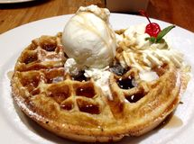 Hot delicious homemade Belgium waffles and maple syrup ice cream and cream Stock Photo