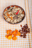 Hot delicious pilaf on a turkish dish on yellow tablecloth. With Royalty Free Stock Images