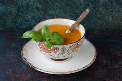 Hot delicious pumpkin soup. In a bowl with a basil Stock Image