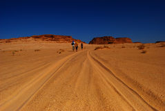 Hot desert in africa. Hot road in desert with a blue sky Royalty Free Stock Image