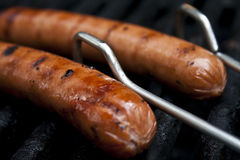 Hot diggity dog. A picture of two hot dogs on a grill Stock Photo