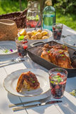 Hot dinner with chicken and potatoes served in sunny day. Closeup of hot dinner with chicken and potatoes served in sunny day Stock Images