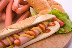 Hot dog. On bun with yellow mustard and ketchup Royalty Free Stock Photo
