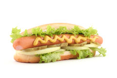 Hot dog. With salad, cucumber and onion on white background Royalty Free Stock Photos