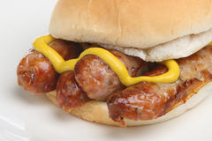 Hot Dog. Pork sausages in a soft white bread roll with English mustard Stock Images