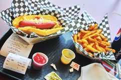 Tray with hot dog and fries. Hot dog in an american diner royalty free stock photos