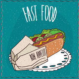 Hot-dog appétissant dans un paquet de papier Images libres de droits