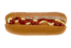 Hot dog in a bun with sauce Stock Photos