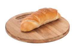Hot dog bun on the wooden board Royalty Free Stock Photography