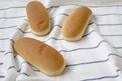 Hot dog buns on striped napkin, side view. Close-up Stock Photos