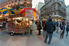 Hot dog cart. Street Food Carts in walkside, several people, photo taken in Manhattan, NYC Stock Photos