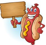 Hot Dog Cartoon Holding a Blank Wooden Sign. A happy hot dog character holding a blank wooden sign, perfect for advertising restaurants or food specials Stock Images
