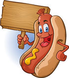 Hot Dog Character Holding Sign. A smiling hot dog character holding a wooden sign, perfect for a food related message Stock Image