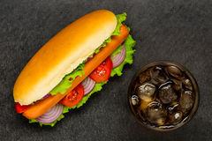 Hot Dog With Cold Cola and Ice on Dark Background Royalty Free Stock Image