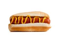 Hot dog con senape su una priorità bassa bianca Immagine Stock Libera da Diritti