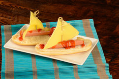 Hot dog. A hot dog decorated as a sailboat, creative kid snack Royalty Free Stock Photo