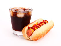 Hot dog and drink. Black drink and hot dog over lettuce over white background royalty free stock photography