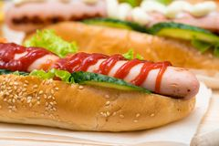 Hot dog drizzled with tomato ketchup royalty free stock image