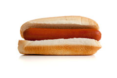 Hot-dog et pain sur le blanc Photographie stock libre de droits