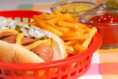Hot dog with french fries Stock Photo