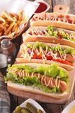 Hot dog with french fries. On board royalty free stock photo