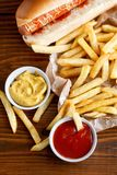 Hot dog and french fries in the restaurant Stock Photos