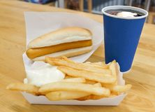 Hot Dog with French Fries and Soda Drinks. Fast Food, Delicious Hot Dog and French Fries Served with Soda Drink. Selective Focus Royalty Free Stock Photos
