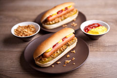 Hot dog with gherkin and onions Stock Photos