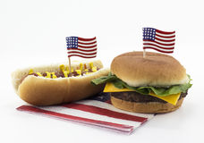 Hot dog and Hamburger on an American flag napkin and toothpick Royalty Free Stock Images