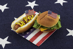 Hot dog and Hamburger on an American flag napkin and toothpick Royalty Free Stock Photo