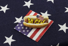 Hot dog and Hamburger on an American flag napkin and toothpick Stock Photos