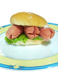 Hot dog in hamburger bread Royalty Free Stock Images