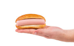 Hot dog in hand. Royalty Free Stock Photography