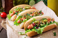 Hot dog with jalapeno peppers, tomato, cucumber and lettuce Royalty Free Stock Image