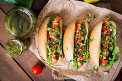 Hot dog with jalapeno peppers, tomato, cucumber and lettuce Stock Image