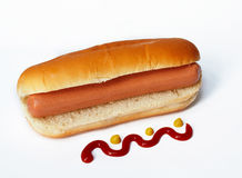 Hot dog with ketchup. Isolated stock photo