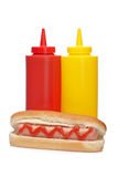Hot dog with ketchup and mustard bottles Stock Photos