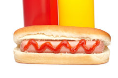 Hot dog with ketchup and mustard bottles Stock Photo