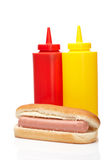 Hot dog with ketchup and mustard bottles Royalty Free Stock Images