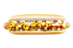 Hot dog. With ketchup , mustard , cucumber and chopped onion , isolated on white , front view Royalty Free Stock Images