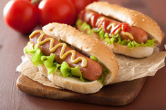 Hot dog with ketchup mustard and lettuce Royalty Free Stock Photos