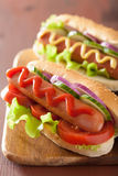 Hot dog with ketchup mustard and lettuce Royalty Free Stock Images