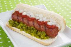 Hot Dog With Ketchup, Relish & Onion Royalty Free Stock Photos