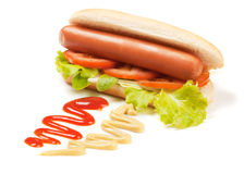 Hot dog with lettuce and tomato Royalty Free Stock Images