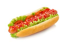 Hot dog with lettuce and tomato on white. Hot dog with lettuce and tomato isolated on white royalty free stock images