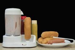 Hot dog maszyna z kiełbasy inside i bieg, Obraz Royalty Free